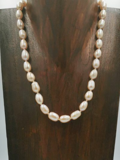 Light pink near-oval freshwater pearl necklace