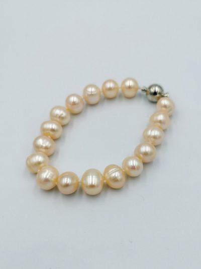 Peach-coloured potato-shaped freshwater pearl bracelet