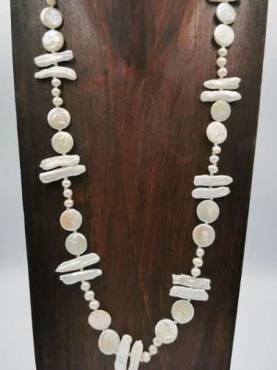 Exclusive necklace design featuring off-white freshwater pearl necklace