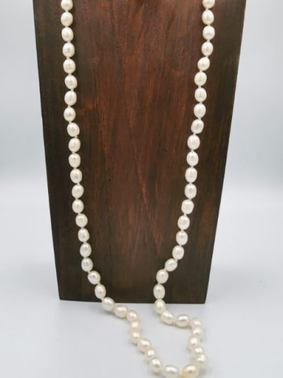 Long off-white oval freshwater pearl necklace