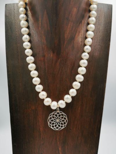White potato-shaped freshwater pearl necklace and sterling silver pendant