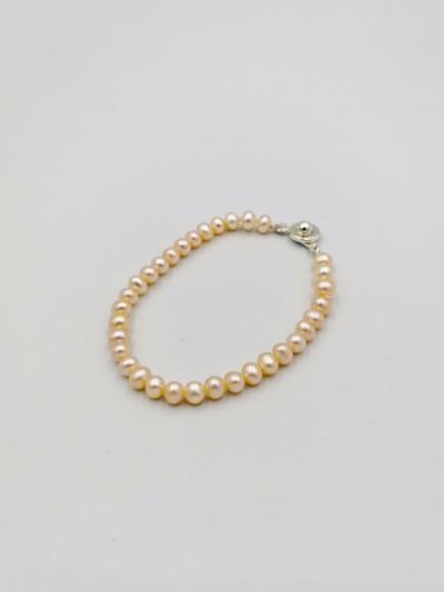 Petite light apricot oval-shaped freshwater pearl bracelet