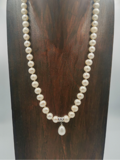 Exclusive necklace featuring white potato shaped freshwater pearls measuring (7-8)mm, with a freshwater pearl drop, silver and cubic zirconia pendant. Total necklace length 47cm (excluding drop pendant).
