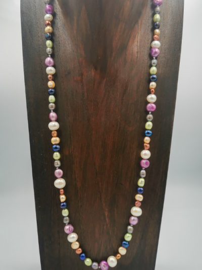 Strand of mixed multi-coloured freshwater pearls, with a toggle clasp. Total necklace length 64cm.