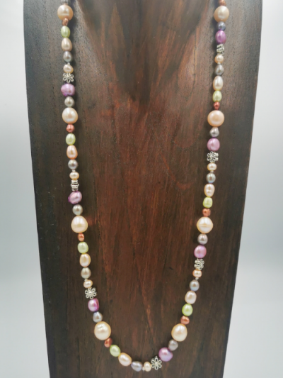 Strand of mixed multi-coloured freshwater pearls and flower detail, with a toggle clasp. Total necklace length 62cm.