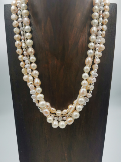 Exclusive necklace design featuring four strands of mixed freshwater pearls, with a slider clasp. Total necklace length 46cm.