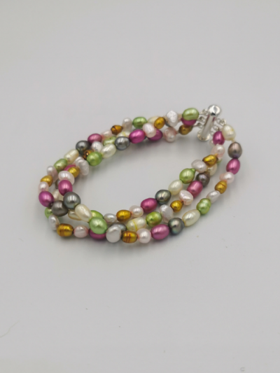 Bracelet comprising 3 strands of mixed multi-coloured freshwater pearls, with a slider clasp. Total bracelet length 19cm.