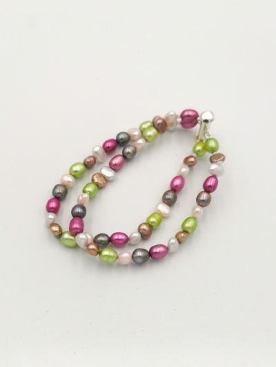 Bracelet comprising 2 strands of mixed multi-coloured freshwater pearls, with a slider clasp. Total bracelet length 18cm.