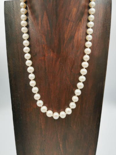 Strand of white potato-shaped freshwater pearls measuring (7-8)mm, with a gold-plated S-hook clasp. Total necklace length 46.5cm.
